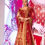 Asian Wedding Experience Catwalk | bride in red and gold lengha