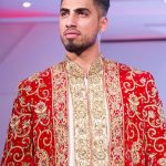 Asian Wedding Experience Catwalk | Groom in gold and red asian sherwani