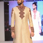 Asian Wedding Experience 2016 catwalk | Groom in gold with red detail sherwani